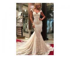 De vanzare  rochie de mireasa stil sirena cu 2500 pietre swarovski+voal lung.